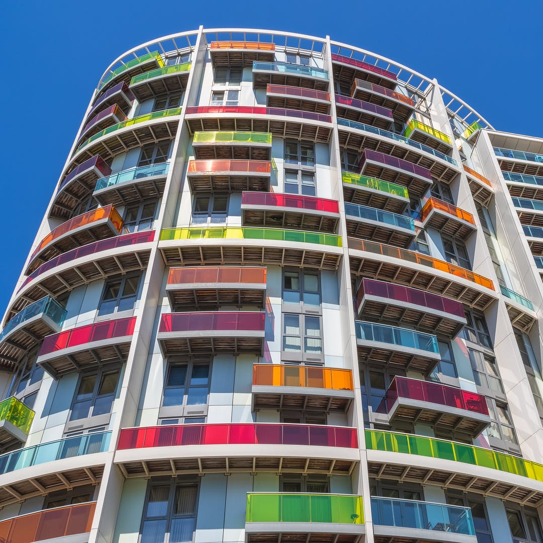 Apartment building with colourful balcony panels